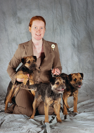 Tegan Whalan, pictured with Myrtle, Clover, and Winnie - three of her border terriers.