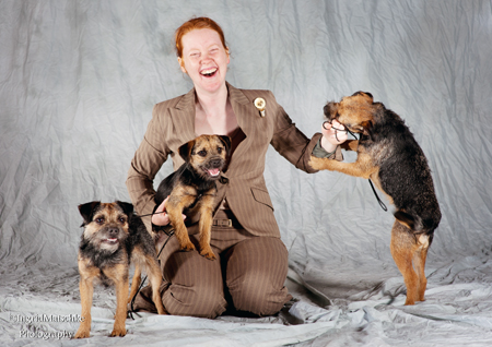 Tegan Whalan with three blue and tan border terrier bitches.